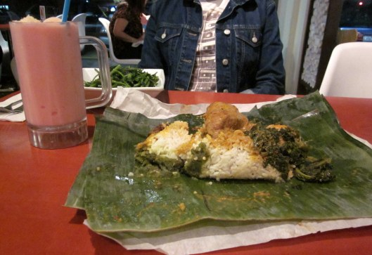 Nasi Bunkus - it comes wrapped in a banana leaf